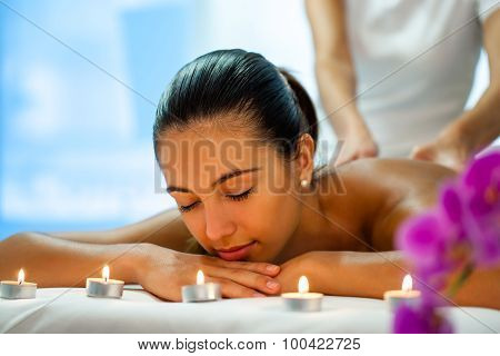 Woman Enjoying Body Treatment In Spa.