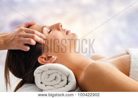 Woman Having Relaxing Facial Massage.