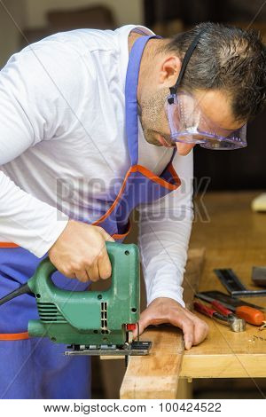 Carpenter Cutting Wood With A Chainsaw