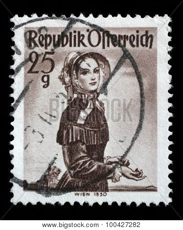 AUSTRIA - CIRCA 1948: A stamp printed in Austria from the Provincial Costumes issue shows a woman from Vienna (1850), circa 1948.