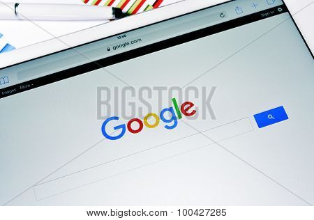 BARCELONA, SPAIN - SEPTEMBER 2, 2015: A tablet computer with the Google Web Search homepage in its screen with the new Google logo, launched in September 1