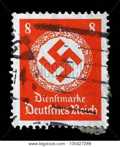 GERMANY - CIRCA 1943: A postage stamp printed in Germany shows the Swastika in an oak wreath, circa 1943.