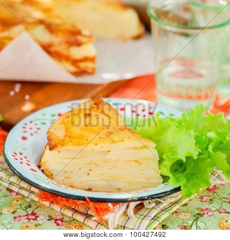 A Slice Of Layered Potato Bake