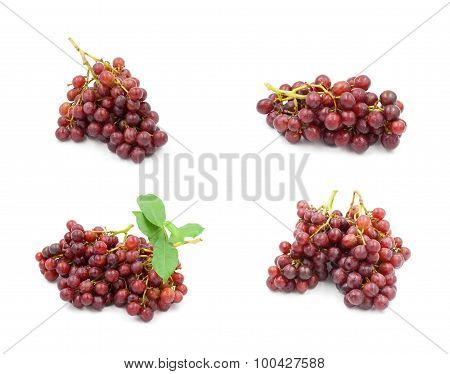 Red Seedless Grapes On A White Background.