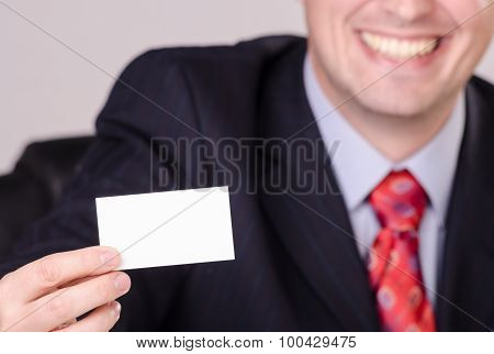 Handsome Smiling Businessman Showing Business Card With Space For Your Text