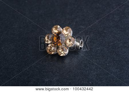 Brooch. Brooch On The Background