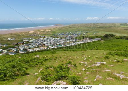 View from Rhossili Down to Burry Holms and Hillend The Gower peninsula Wales UK with caravans