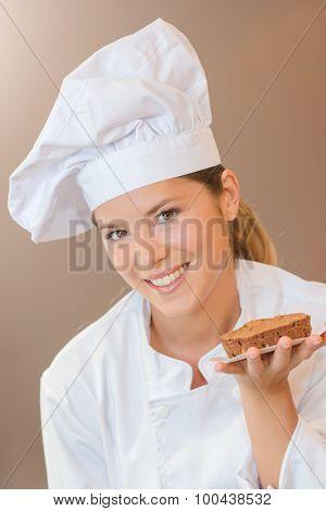 Baker holding a chocolate dessert