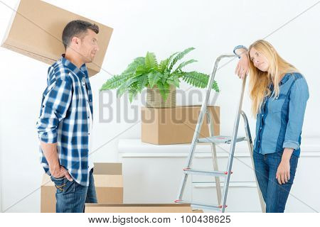 Couple feeling tired after moving house