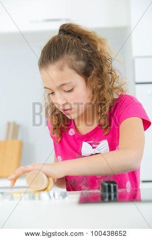 Little girl baking at home