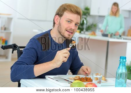 Disabled man having his lunch
