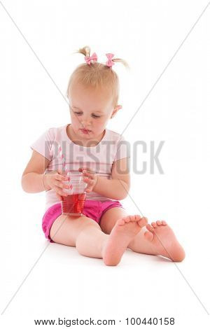 Toddler girl standing in mothers big shoes isolated over white background