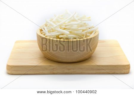Bean sprouts on wooden plate, white background