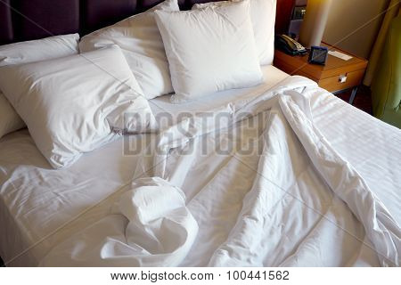 unmade hotel bed