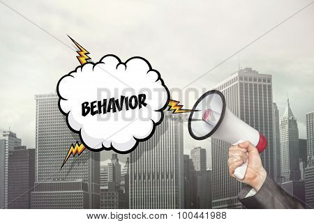 Behavior text on speech bubble and businessman hand holding megaphone