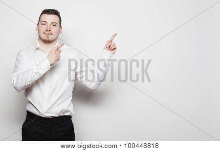 life style, business  and people concept: business man points with fingers in the right side over white background.