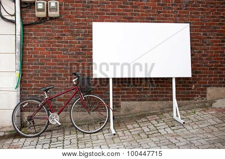 Blank Advertisement Board At Street With Bicycle Next To It
