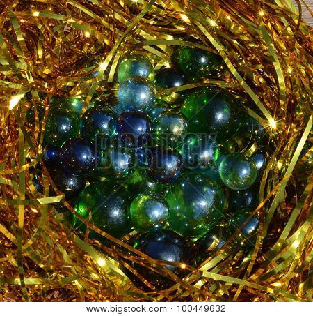 blue balls surrounded by tinsel