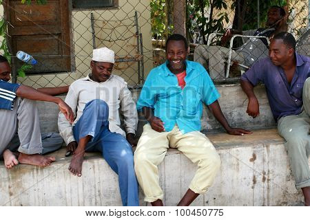 Several African Men Have A Rest In The Shade.