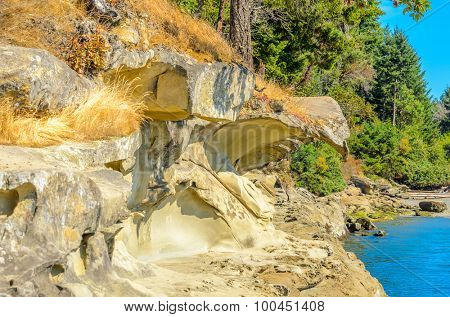Rocky beach and ocean scenic for vacations and summer getaways. Famous Galaspina Rock Gallery at Gabriola Island, BC, Canada.