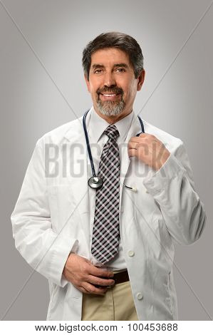 Hispanic doctor smiling over gray background