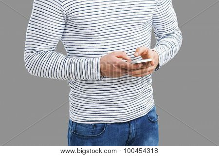 Young man sending a text message, isolated on white background