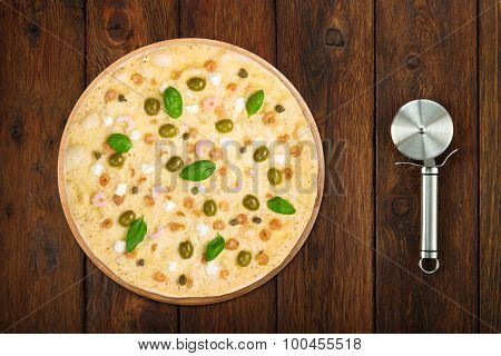 Delicious Seafood Pizza With Olives Steel Cutter