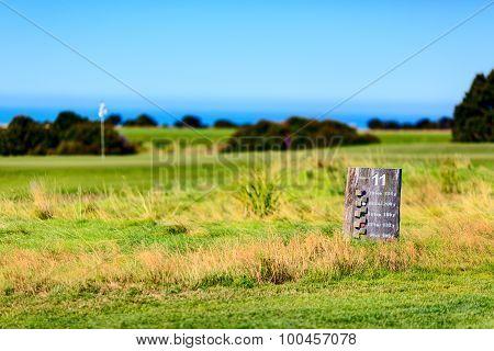 Hole wooden board. Public golf court. New Zealand
