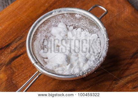 Powdered Sugar In A Sieve