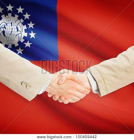 Businessmen Handshake With Flag On Background - Burma