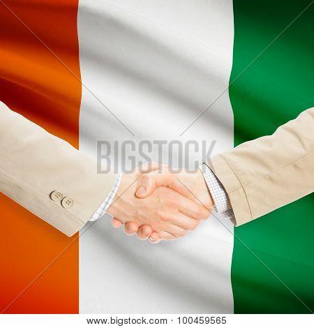 Businessmen Handshake With Flag On Background - Ivory Coast