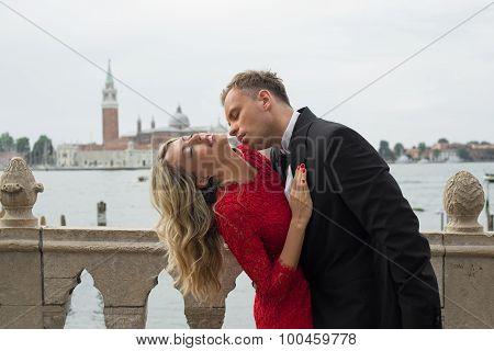 Elegant couple kissing passionately