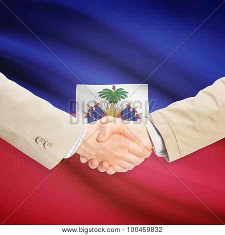Businessmen Handshake With Flag On Background - Haiti