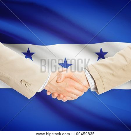 Businessmen Handshake With Flag On Background - Honduras