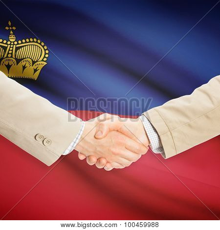 Businessmen Handshake With Flag On Background - Liechtenstein