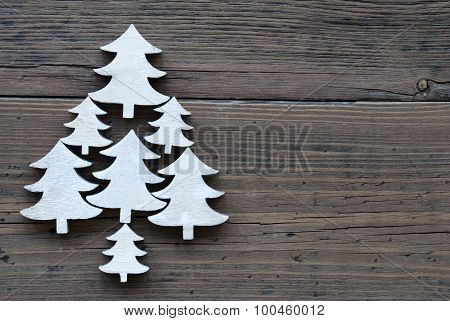 Christmas Trees On  Brown Wooden Background