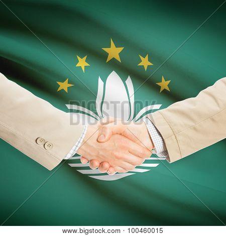 Businessmen Handshake With Flag On Background - Macau