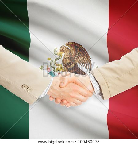 Businessmen Handshake With Flag On Background - Mexico