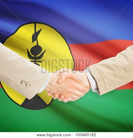 Businessmen Handshake With Flag On Background - New Caledonia