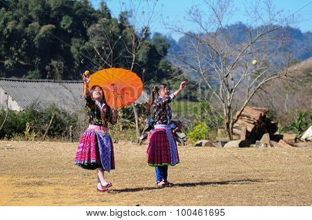 H'mong ethnic minority girls play traditional game with tenis ball in Mocchau,
