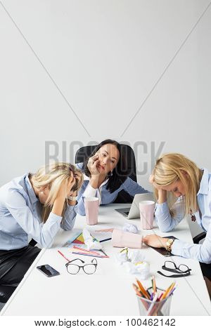 Exhausted women in the office