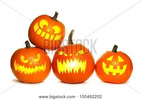 Group of Halloween Jack o Lanterns isolated on white