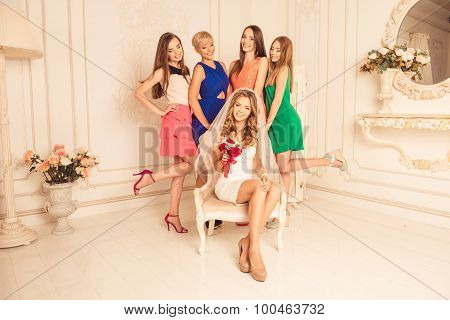 Beautiful And Happy Bride With Her Girlfriends