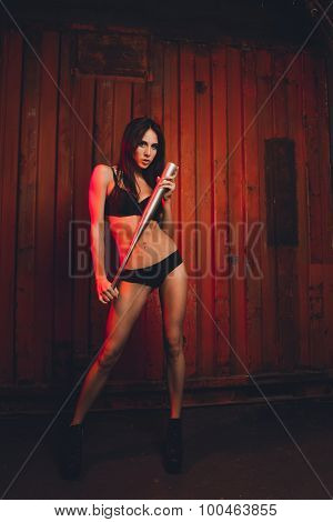 Sexy Girl In Lingerie Holding A Bat In Her Hands