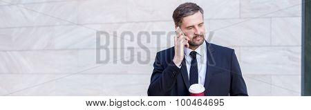 Businessperson With Coffee And Phone