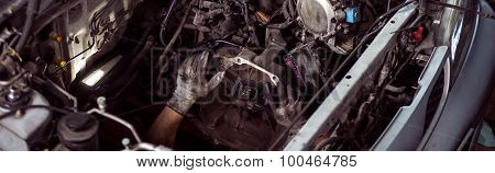 Close-up Of Fixing The Engine