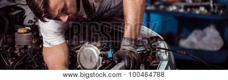 Motor Mechanic Repairing Car Engine