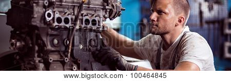 Repairer Fixing Car Engine