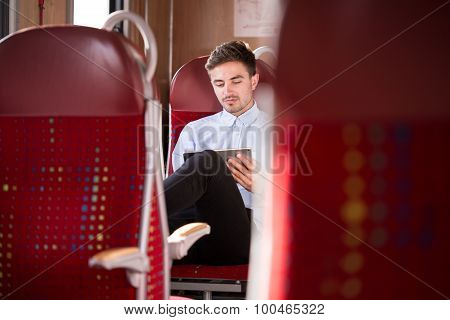 Businessman Travelling By Bus