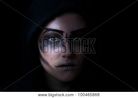 Girl In Hoodie With Scary Face Makeup On Black Background